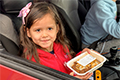 Donation eCard: Little girl in a car with food